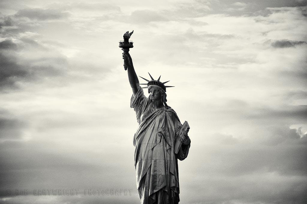 Statue of Liberty Ellis Island Staten Island Ferry NY NYC New York Architecture America USA US united states travel nikon D40 photography photo picture image bw black and white mono monochrome icon iconic sky c