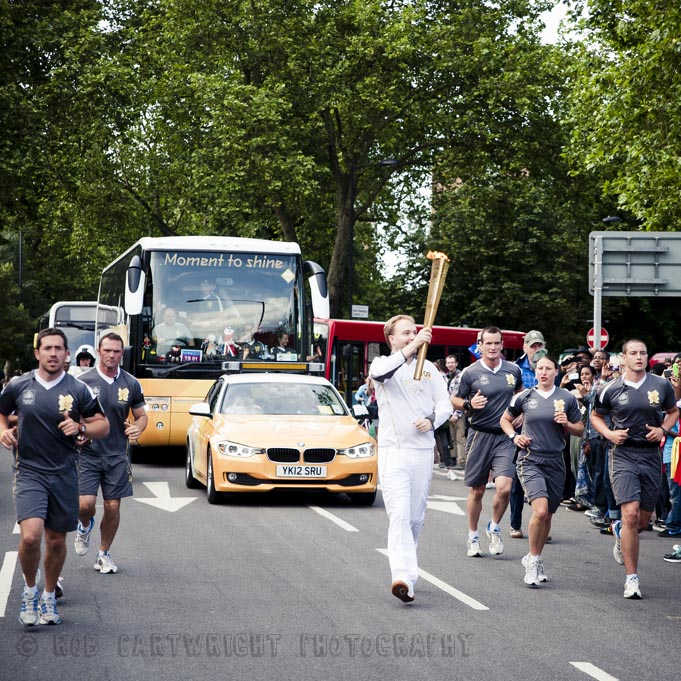 olympic torch relay hackney london 2012 Saturday 21 July olympics torchbearer Jonty Wareing rectory road flame streettogs street photography photojournalism rob cartwright